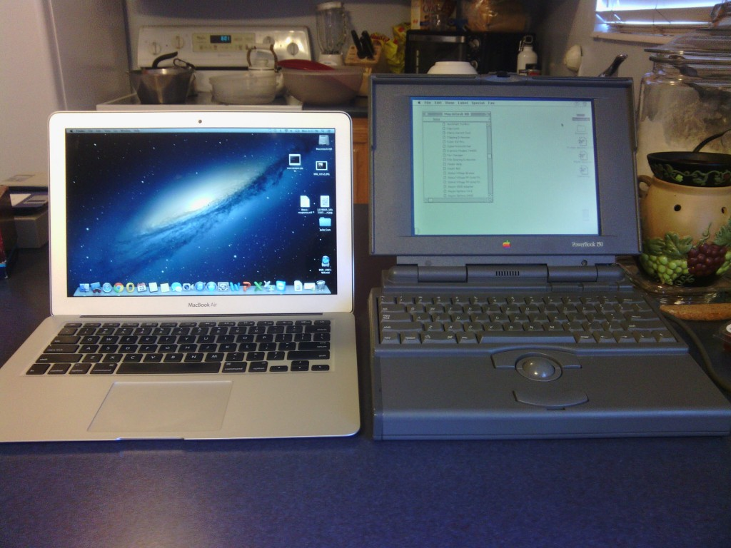 The 2013 Macbook Air side by side with the 1994 Apple PowerBook 150