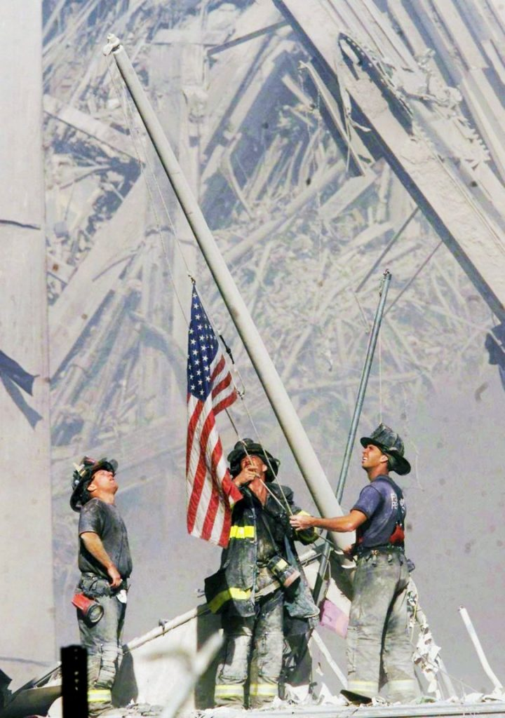 Old Glory is raised upon the wreckage of the World Trade Center